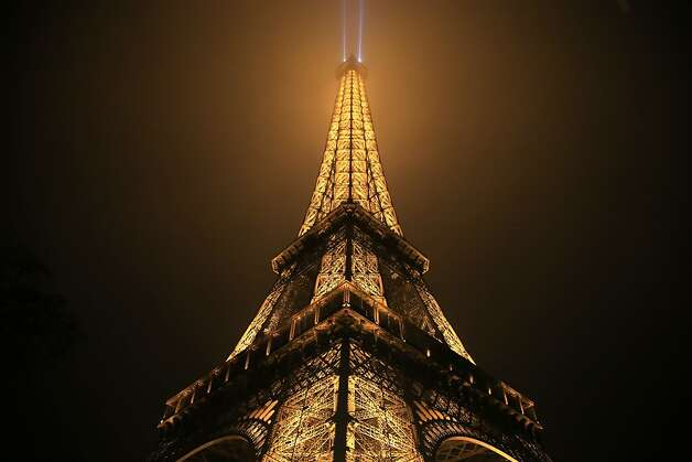 The Eiffel tower is seen on a foggy night in Paris on February 28, 2013. The tower was completed in 1889 and it's current total height is 324 meters. Photo: Alexander Klein, AFP/Getty Images