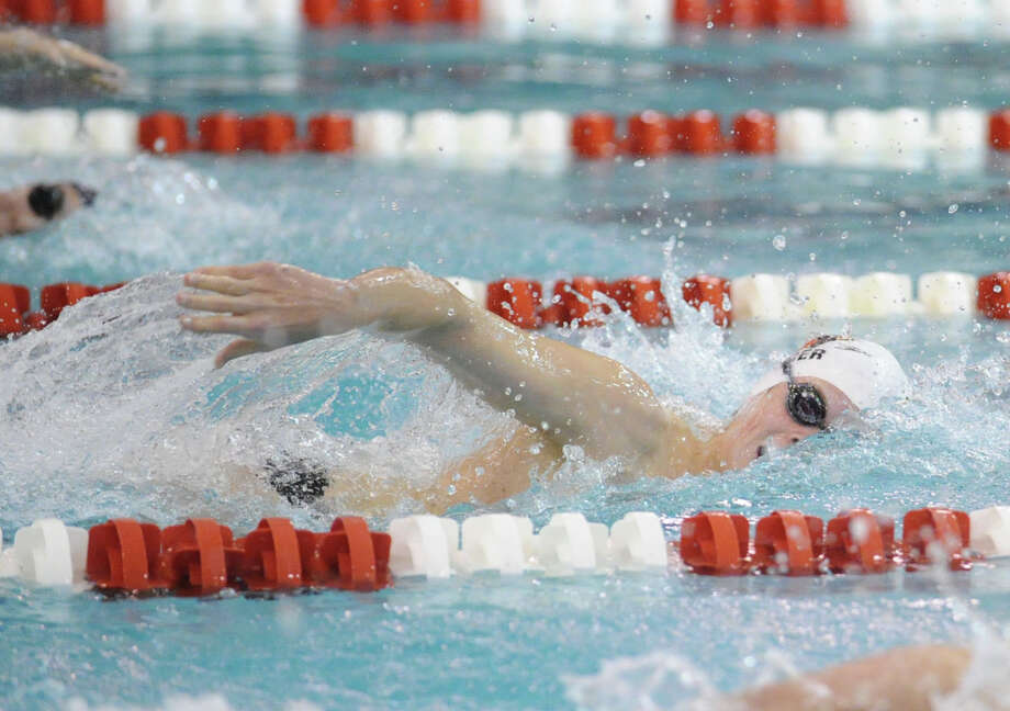 Thomas Dillinger of Greenwich High School swims in the 500 freestyle event during the FCIAC Swimming championships at Greenwich High School, Thursday night, Feb. 28, 2013. Photo: Bob Luckey / Greenwich Time
