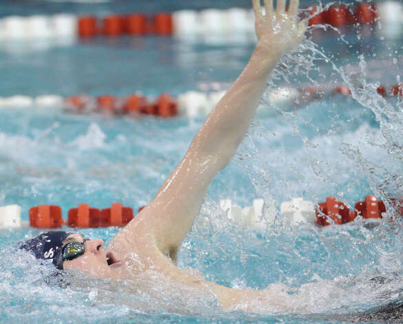 Sean Higgins of Wilton High School swims in 200 medley relay event during the FCIAC Swimming championships at Greenwich High School, Thursday night, Feb. 28, 2013. Photo: Bob Luckey / Greenwich Time