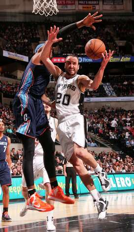 The Spurs' Manu Ginobili drives through Charlotte Bobcats' Brendan Haywood during the first half at the AT&T Center, Wednesday, Jan. 30, 2013. Photo: Jerry Lara, San Antonio Express-News / © 2013 San Antonio Express-News