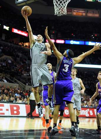 Manu Ginobili of the Spurs shoots and scores over Jared Dudley of the Phoenix Suns during NBA action at the AT&T Center on Saturday, Jan. 26, 2013. Photo: Billy Calzada, San Antonio Express-News / SAN ANTONIO EXPRESS-NEWS