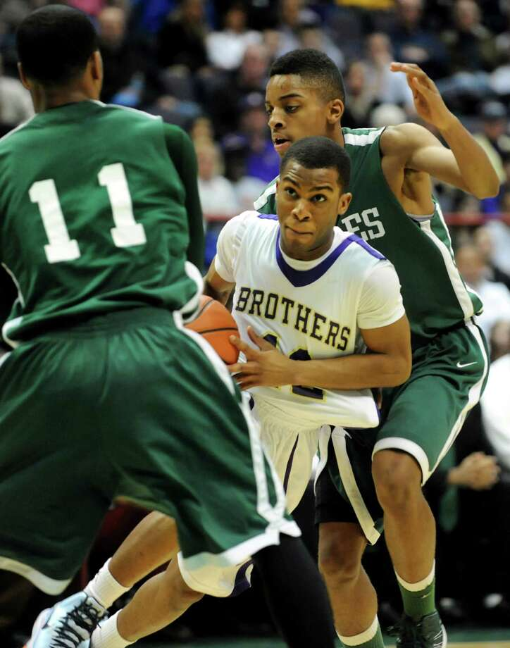 CBA's Tyrell Ramsey (12), center, controls the ball as Green Tech's Jizziah Carr (11), left, and David Clark (5) defend during their Class AA semifinal basketball game on Thursday, Feb. 28, 2013, at Times Union Center in Albany, N.Y. (Cindy Schultz / Times Union) Photo: Cindy Schultz / 00021357A