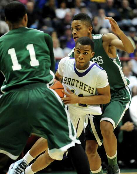 CBA's Tyrell Ramsey (12), center, controls the ball as Green Tech's Jizziah Carr (11), left, and Dav