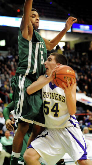 CBA's Greig Stire (54), right, looks to shoot as Green Tech's David Clark (5) defends during their C