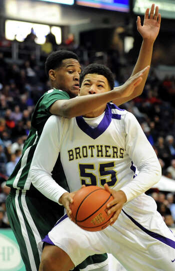 Green Tech's Ramion Burt (35), left, fouls on CBA's Brian Renauld (55) during their Class AA semifin