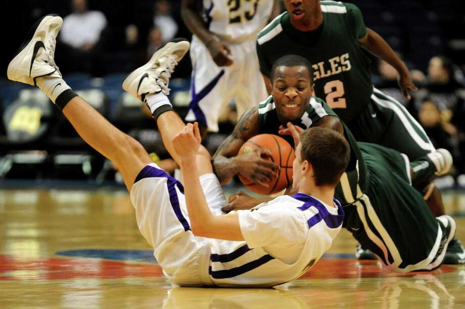 CBA's Drew Brundige (31), bottom, battles for a loose ball with Green Tech's Maurice West (10) during their Class AA semifinal basketball game on Thursday, Feb. 28, 2013, at Times Union Center in Albany, N.Y. (Cindy Schultz / Times Union) Photo: Cindy Schultz / 00021357A