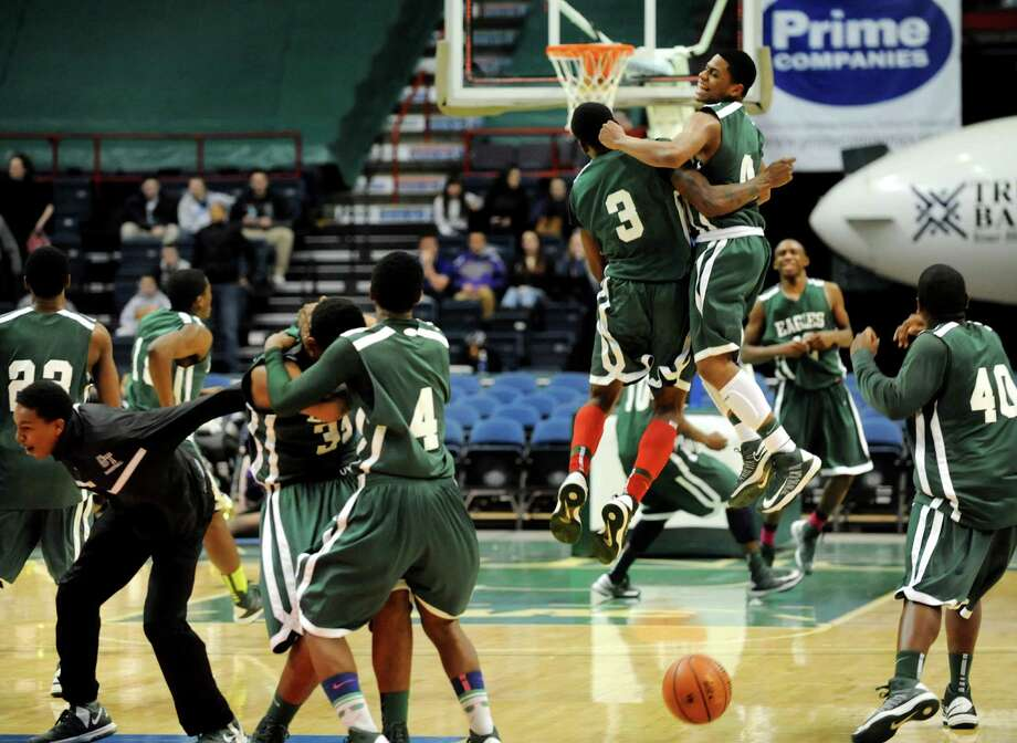 Green Tech players erupt with joy when they win 64-60 over CBA in their Class AA semifinal basketball game on Thursday, Feb. 28, 2013, at Times Union Center in Albany, N.Y. (Cindy Schultz / Times Union) Photo: Cindy Schultz / 00021357A