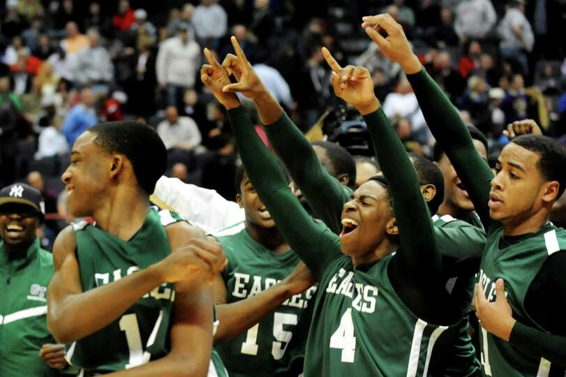Green Tech players celebrate winning 64-60 over CBA in their Class AA semifinal basketball game on T