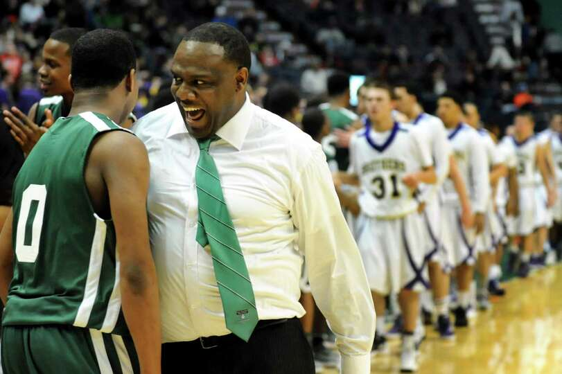 Green Tech coach Jamil Hood celebrates winning 64-60 over CBA in their Class AA semifinal basketball