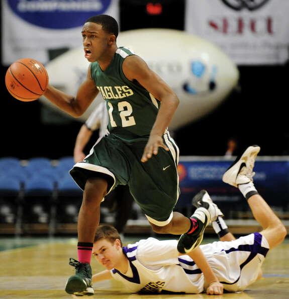 Green Tech's Jamil Hood Jr. (12) runs up court to seal the game with a final basket as CBA's Drew Br