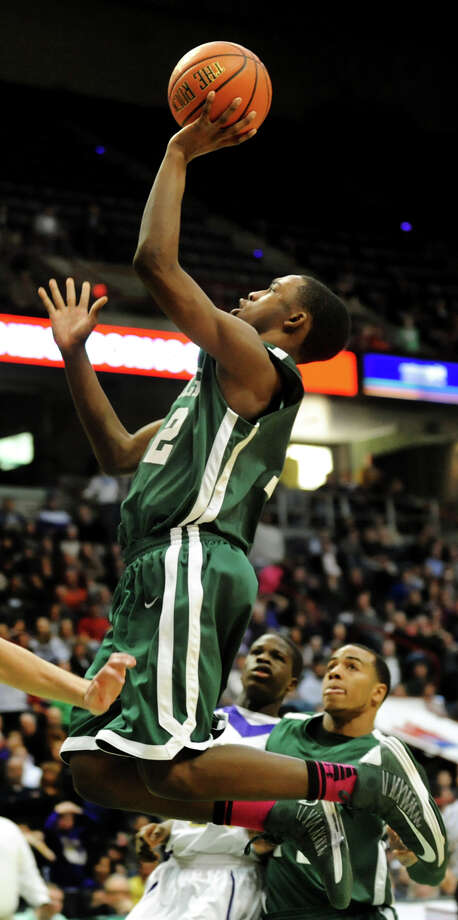 Green Tech's Jamil Hood Jr. (12) jumps and makes the shot to make the score 64-60 during their Class AA semifinal basketball game against CBA on Thursday, Feb. 28, 2013, at Times Union Center in Albany, N.Y. (Cindy Schultz / Times Union) Photo: Cindy Schultz / 00021357A