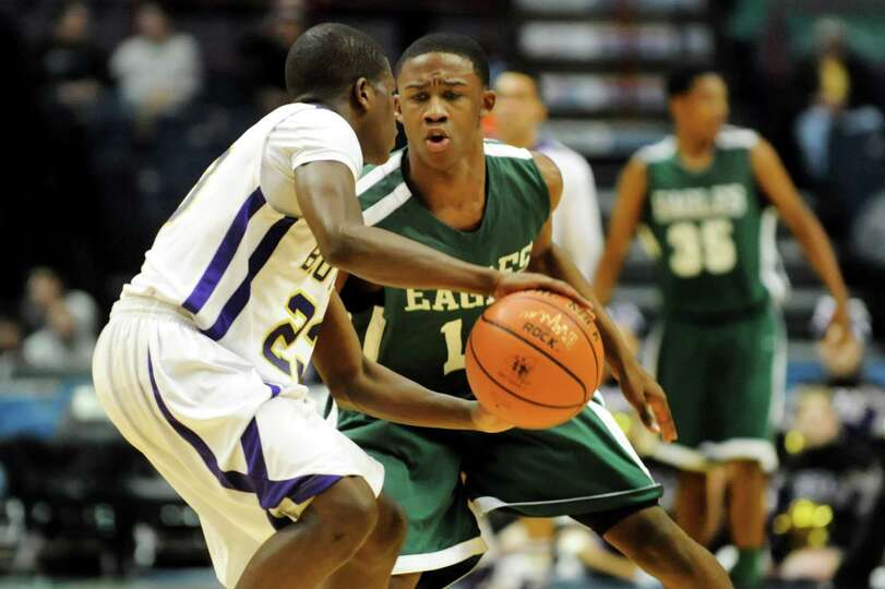 Green Tech's Jamil Hood Jr. (12) defends against CBA's Daniel Owens (23) during their Class AA semif