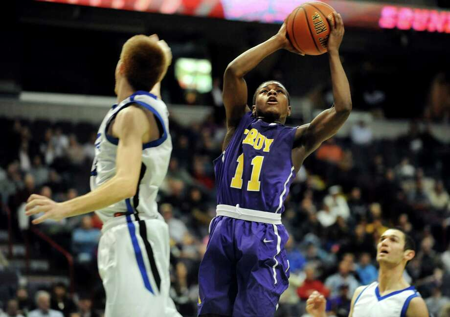 Troy's Dyaire Holt (11) shoots for the hoop during their Class AA semifinal basketball game against Shaker on Thursday, Feb. 28, 2013, at Times Union Center in Albany, N.Y. Troy wins 52-36. (Cindy Schultz / Times Union) Photo: Cindy Schultz / 00021357A