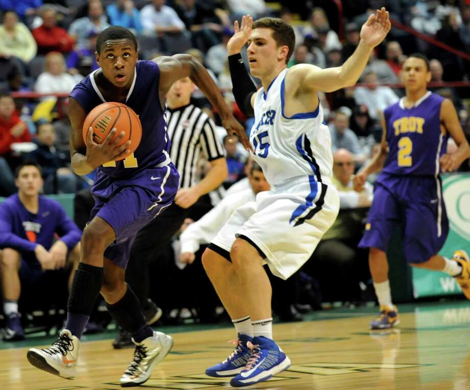 Troy's Dyaire Holt (11), left, drives towards the hoop as Shaker's Zach Yakel (15) defends during their Class AA semifinal basketball game on Thursday, Feb. 28, 2013, at Times Union Center in Albany, N.Y. (Cindy Schultz / Times Union) Photo: Cindy Schultz / 00021357A