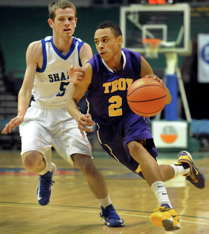 Troy's Jordan Nelson (2), right, drives past Shaker's Justin Carmello (5) during their Class AA semifinal basketball game on Thursday, Feb. 28, 2013, at Times Union Center in Albany, N.Y. (Cindy Schultz / Times Union) Photo: Cindy Schultz / 00021357A