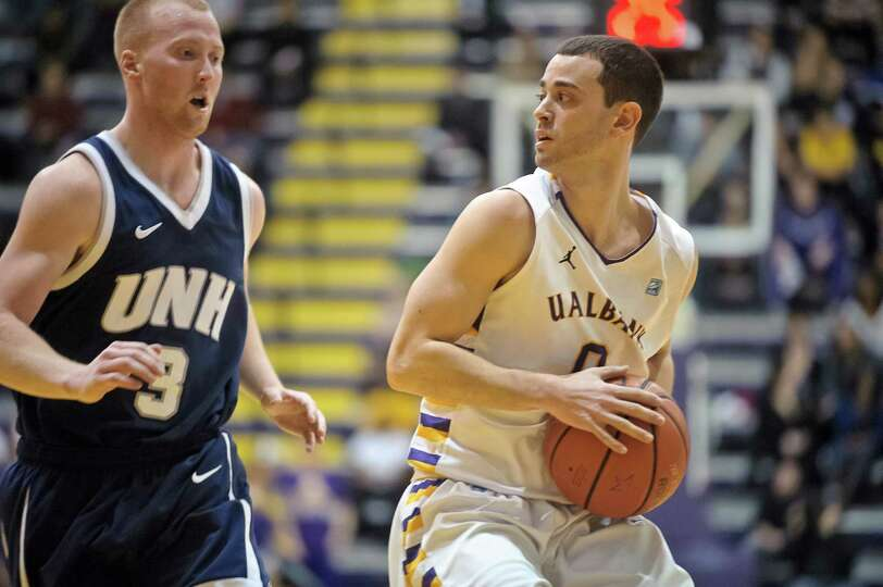 University at Albany Basketball's Senior Jacob Iati looks to get past UNH's Chandler Rhoads Thursday