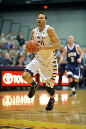 University at Albany's Gary Johnson moves the ball up the court,  Thursday Feb. 28, 2013, during the