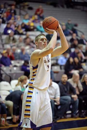 University at Albany's Luke Devlin lines up for a basket,  Thursday Feb. 28, 2013, during the game a