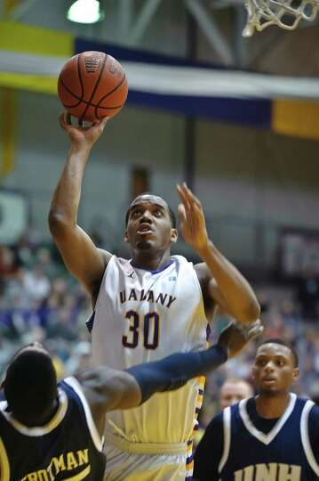 University at Albany's Jayson Guerrier goes for a basket against UNH,  Thursday Feb. 28, 2013, at SE
