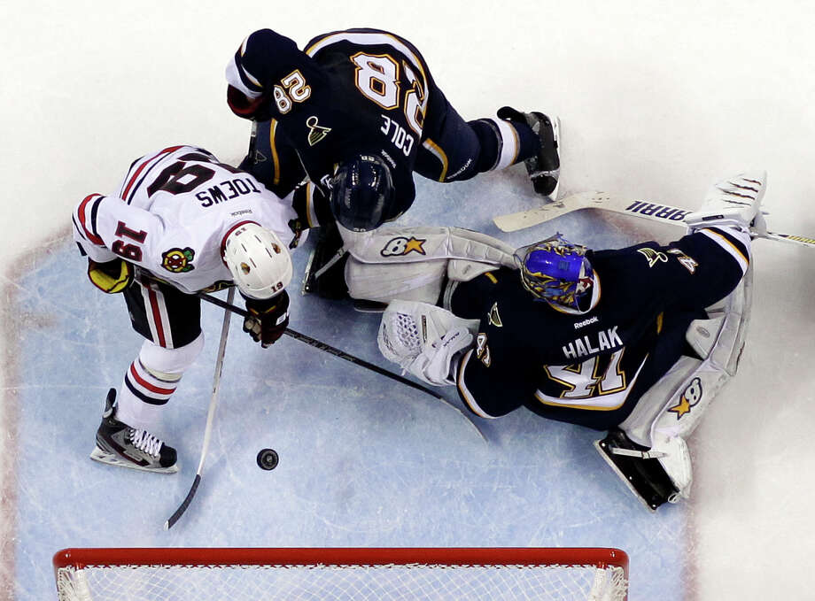 Chicago Blackhawks' Jonathan Toews, left, scores his second goal of an NHL hockey game as St. Louis Blues goalie Jaroslav Halak, of Slovakia, and Ian Cole, center, defend during the third period, Thursday, Feb. 28, 2013, in St. Louis. The Blackhawks won 3-0. (AP Photo/Jeff Roberson) Photo: Jeff Roberson
