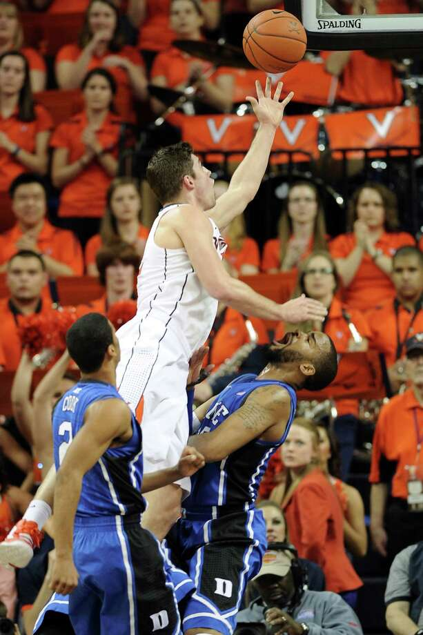 CHARLOTTESVILLE, VA - FEBRUARY 28:  Joe Harris #12 of the Virginia Cavaliers puts up a shot against Josh Hairston #15 of the Duke Blue Devils at John Paul Jones Arena on February 28, 2013 in Charlottesville, Virginia. (Photo by Lance King/Getty Images) Photo: Lance King