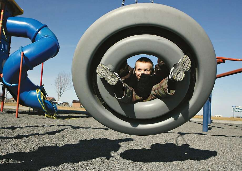 Wait, bombing range?! Five-year-old Jasper Cords play on the swings at the Bombing Range Sports Complex playground in West Richland, Wash. Photo: Kai-Huei Yau, Associated Press