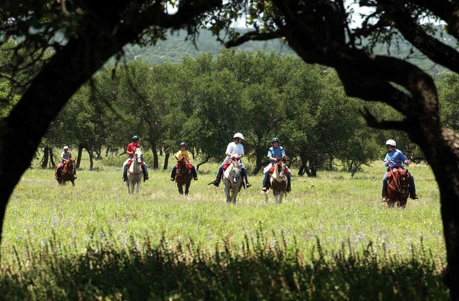 The Y.O. Ranch, near Mountain Home, hosts guided hunts for exotic game. It has 16 rooms for paying guests and about 400 head of cattle. The land originally was purchased by former Texas Ranger Capt. Charles A. Schreiner in 1880. Photo: San Antonio Express-News / File Photos