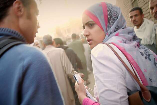 "Journalist Heba Afify (right) reports on the Arab Spring in Cairo in the documentary ""Words of Witness."" Photo: Iskander Films"