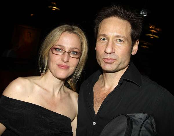 Scully (Gillian Anderson, left) and Mulder (David Duchovny) had great chemistry, even if they weren''t friends in real life. Here''s Anderson and Duchovny in 2010.