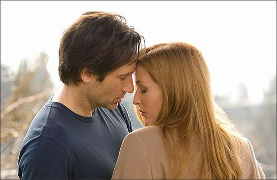 Fans wanted Mulder and Scully to get together, which they did with a kiss in the 2008 movie, ''The X-Files: I Want to Believe.'' / Twentieth Century Fox
