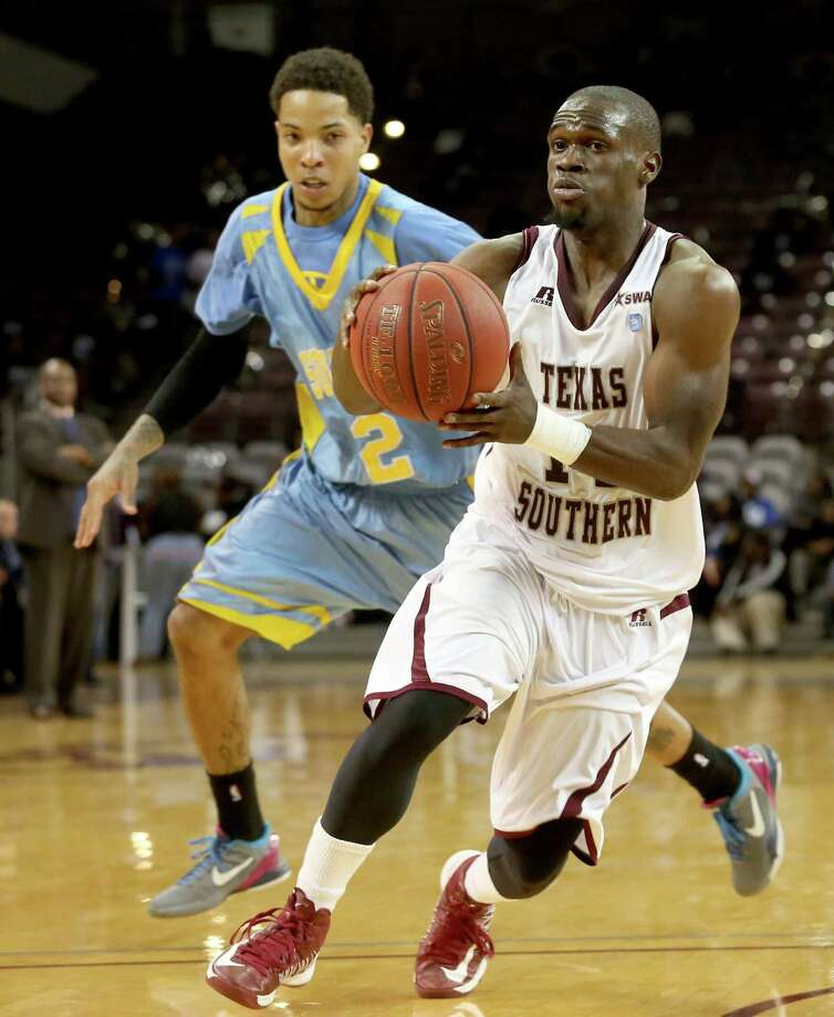 Texas Southern's Ray Penn (14), who scored 14 points, dribbles past Southern's Derick Beltran (2) and looks to pass in the second half Thursday night. Photo: Thomas B. Shea / © 2012 Thomas B. Shea
