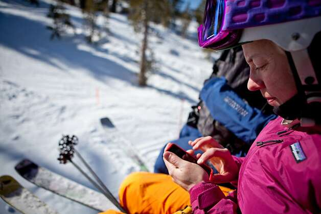 Ski Lake Tahoe interactive manager Jenn Gleckman catches up on work emails during the chair ride up at Heavenly Ski Resort during the fifth annual Snowcial, an event that mixes business with skiing February 28, 2013 in South Lake Tahoe, California. Photo: Max Whittaker/Prime, Special To The Chronicle