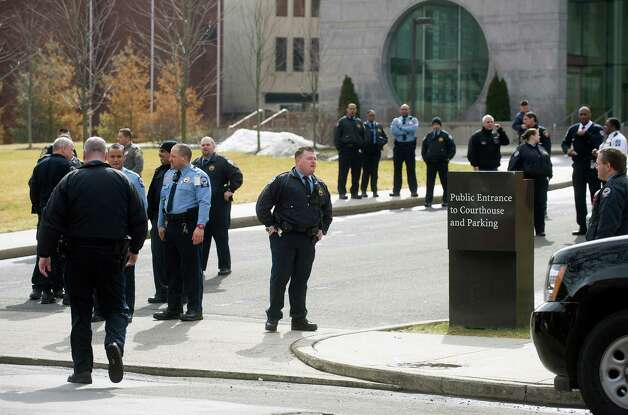 Police officers stand outside the Stamford Superior Court on Thursday, February 28, 2013, as State Police officers inspect the building after a bomb threat was made. Photo: Lindsay Perry / Stamford Advocate