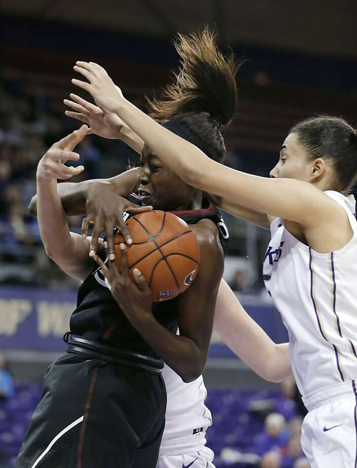 Chiney Ogwumike (left) grabs one of her 13 rebounds - she also had 24 points - in the Cardinal's rout of Washington. Photo: Elaine Thompson, Associated Press