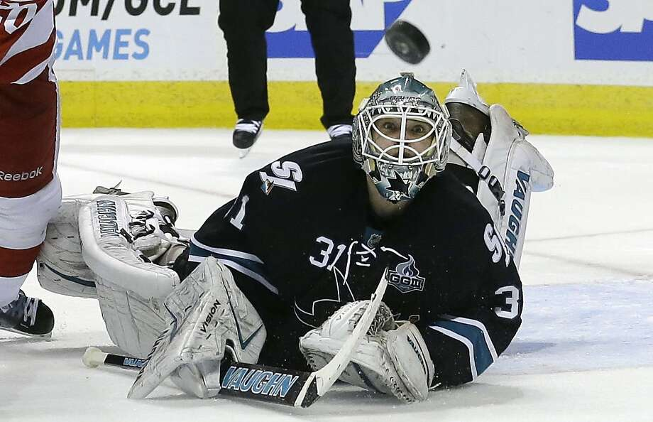 Antti Niemi keeps an eye on the puck above his head in the second period. He stopped all but one of 34 shots through overtime. Photo: Jeff Chiu, Associated Press