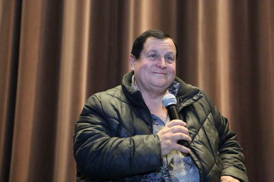 Burt Ward, who played Robin answers questions during Emerald CIty Comicon's A Gotham Night in the Emerald City at Seattle's Cinerama. Ward and actor Adam West, who played Batman, attended a viewing of the 1966 theatrical Batman film on Friday, February 28, 2013 to help kickoff Comicon. (Joshua Trujillo, seattlepi.com)