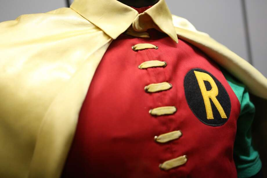 The costume worn by Burt Ward, who played Robin, is shown during Emerald CIty Comicon's A Gotham Night in the Emerald City at Seattle's Cinerama. Ward and actor Adam West, who played Batman, attended a viewing of the 1966 theatrical Batman film on Friday, February 28, 2013 to help kickoff Comicon. (Joshua Trujillo, seattlepi.com)