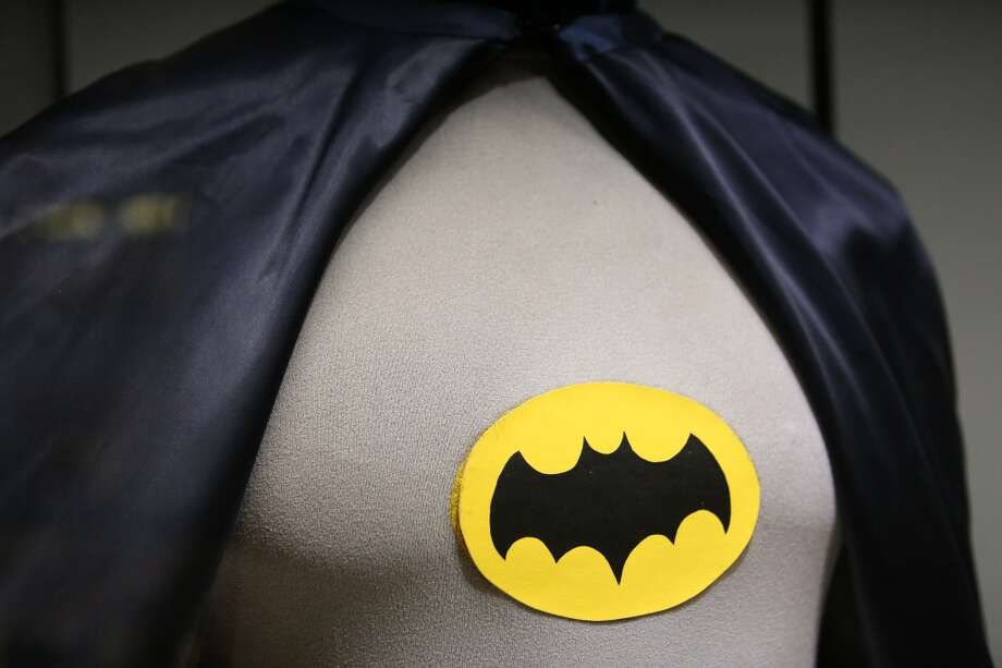 The costume worn by Adam West, who played Batman, is shown during Emerald CIty Comicon's A Gotham Night in the Emerald City at Seattle's Cinerama. West and Burt Ward, who played Robin, attended a viewing of the 1966 theatrical Batman film on Friday, February 28, 2013 to help kickoff Comicon. (Joshua Trujillo, seattlepi.com)