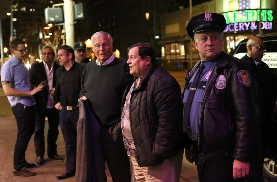 Adam West, who played Batman, and Burt Ward, who played Robin are escorted from their vehicle during Emerald CIty Comicon's A Gotham Night in the Emerald City at Seattle's Cinerama. The actors attended a viewing of the 1966 theatrical Batman film on Friday, February 28, 2013 to help kickoff Comicon. (Joshua Trujillo, seattlepi.com)