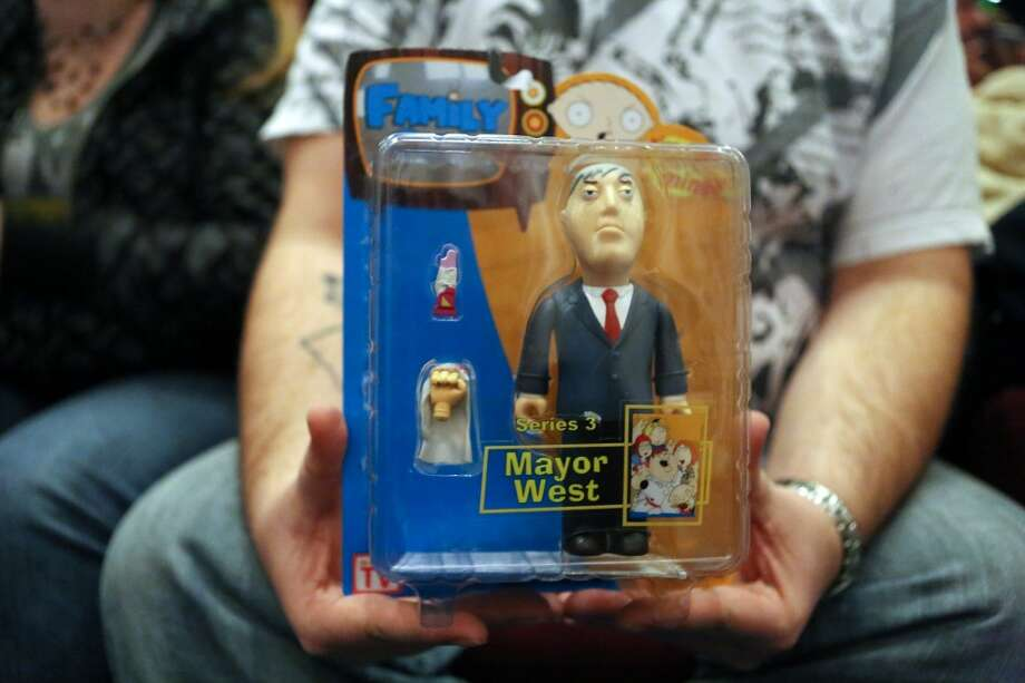 A person holds a toy Mayor West figure during Emerald CIty Comicon's A Gotham Night in the Emerald City at Seattle's Cinerama for viewing of the 1966 theatrical Batman film on Friday, February 28, 2013 to help kickoff Comicon. (Joshua Trujillo, seattlepi.com)