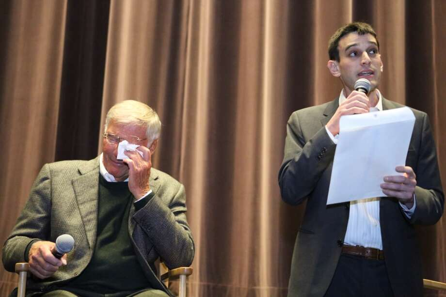 Adam West, who played Batman, pretends to cry as a proclamation is read from Seattle Mayor Mike McGinn  during Emerald City Comicon's A Gotham Night in the Emerald City at Seattle's Cinerama. The actor, along with Burt Ward who played Robin, attended a viewing of the 1966 theatrical Batman film on Friday, February 28, 2013 to help kickoff Comicon. Aaron Fishbone from McGinn's staff is reading the proclamation. (Joshua Trujillo, seattlepi.com)