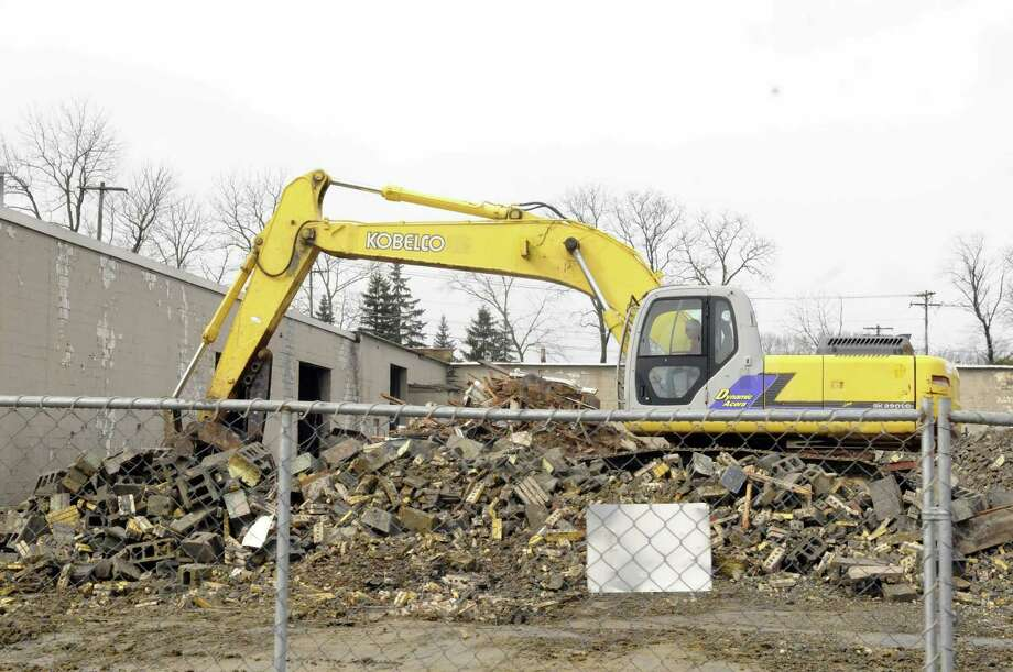 Demolition of former Kiskis Tire at Route 9 and Sparrowbush Road on Thursday Feb. 28, 2013 in Latham, N.Y. (Michael P. Farrell/Times Union) Photo: Michael P. Farrell
