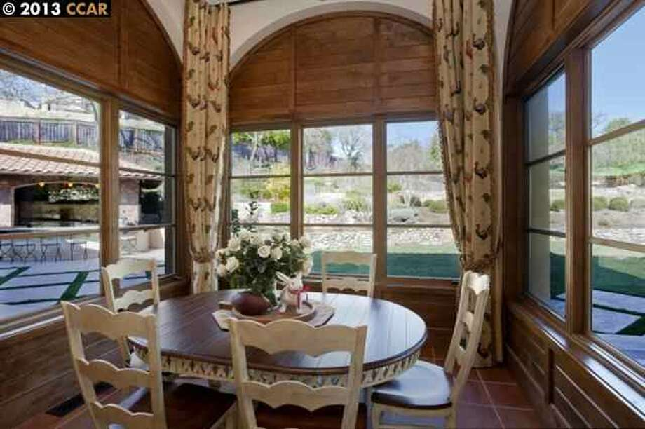Casual dining nook with views of the rear of the property.