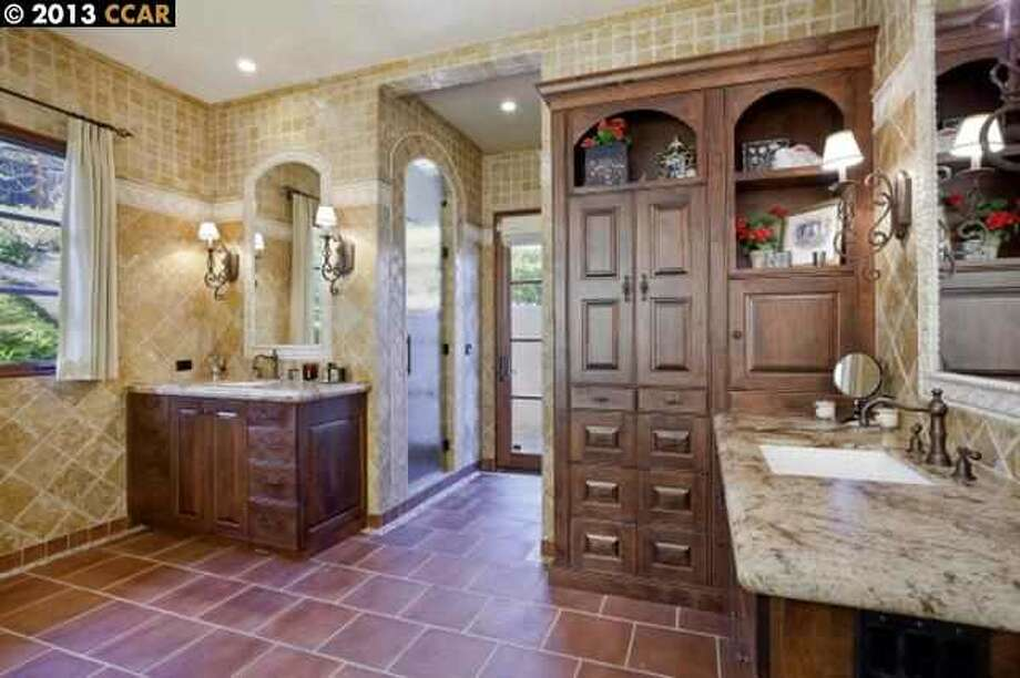 Bathroom with separate vanities and built ins