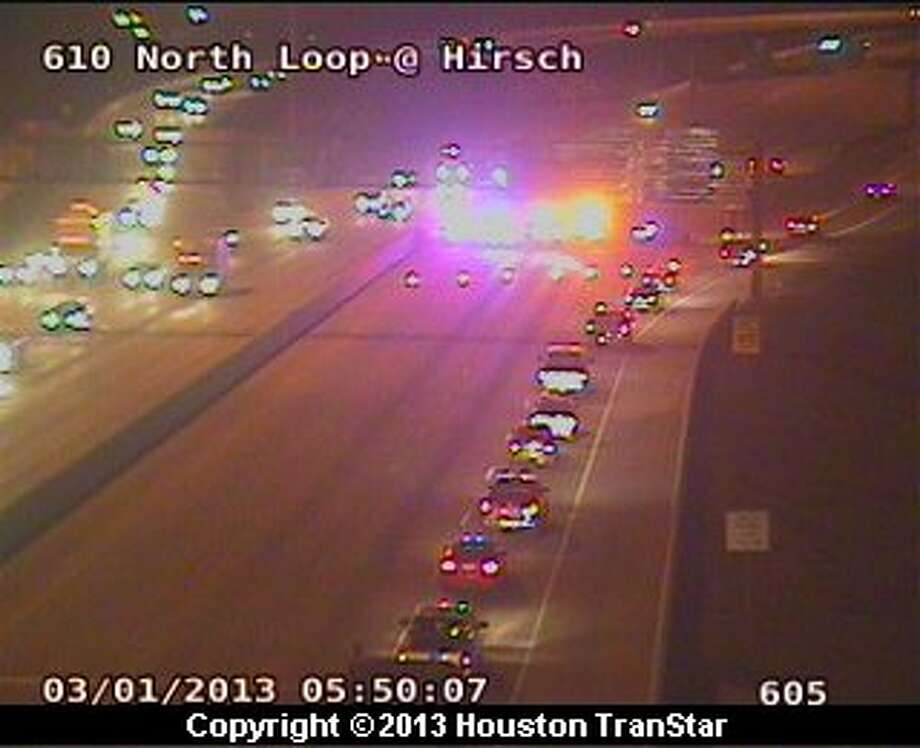 An overturned 18-wheeler temporarily blocked the westbound North Loop near the Eastex Freeway early Friday morning. Photo: Houston Transtar