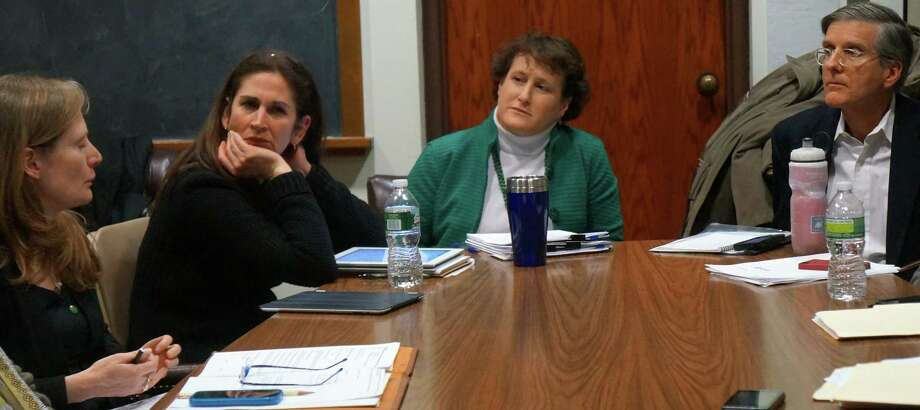 A request for $100,000 to pay for a security survey of town schools was reviewed Thursday at a joint meeting of Representative Town Meeting committees, including, from left:  Eileen Flug, RTM, District 9; Melissa Kane, RTM, District 3, Board of Education Chairwoman Elaine Whitney, and Jeff Wieser, RTM, District 4.  WESTPORT NEWS, CT 2/28/13 Photo: Paul Schott / Westport News