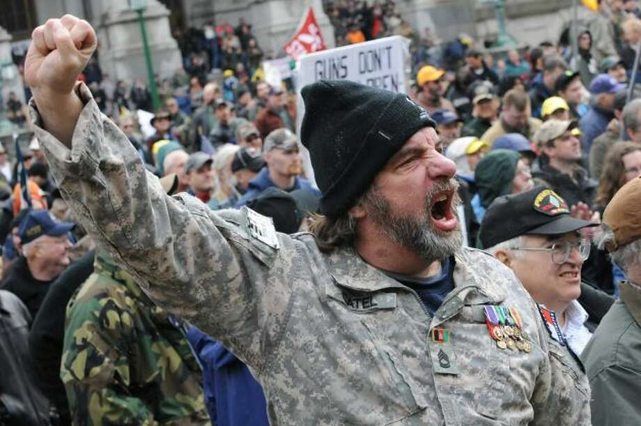 Maurice Catel from Coeymans Hollow lets out a yell with his fist in the air as the New York State Rifle & Pistol Association holds its 5th Annual Lobby Day and Rally at Capitol Park on Wednesday Feb. 27, 2013 in Albany, N.Y. (Lori Van Buren / Times Union)
