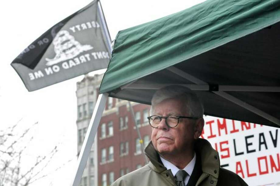NRA President David Keene looks over five thousand people as the New York State Rifle & Pistol Association holds its 5th Annual Lobby Day and Rally at Capitol Park on Wednesday Feb. 27, 2013 in Albany, N.Y. (Lori Van Buren / Times Union)