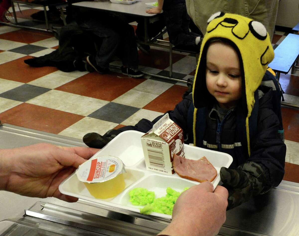 Joseph Tulchinskiy gets some green eggs and ham on Friday, March 1, 2013 in the cafeteria at Troy, N.Y. P.S. 16 on the occasion of Dr. Seuss' 99th birthday. (Skip Dickstein/Times Union)