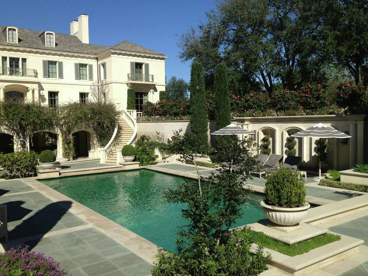John Staub designed this River Oaks home that is now owned by Jim and Cherie Flores. Its previous owners were Oscar and Lynn Wyatt.